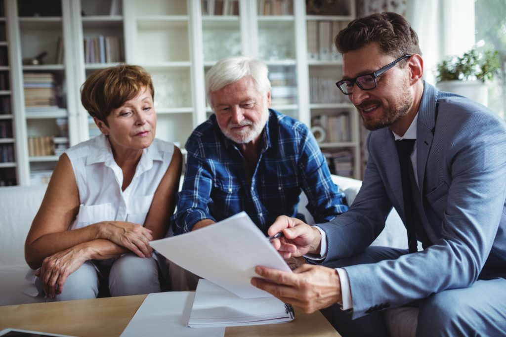 Senior couple planning their investments with financial advisor